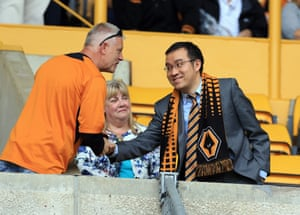New Wolves club director Jeff Shi greets a fan during a pre-season friendly match at Molineux.