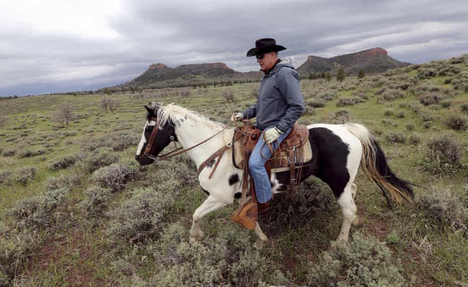 Ryan Zinke rides a horse in Bears Ears, a national monument downsized on his watch.