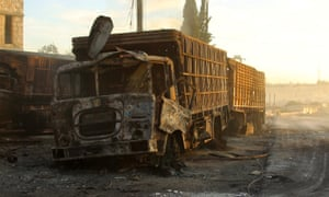 Damaged aid trucks are pictured after an airstrike on the rebel held Urm al-Kubra town, western Aleppo city.