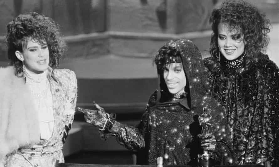 Wendy Melvoin, Prince and Lisa Coleman accept the 1985 Oscar for best original song score for the film Purple Rain.