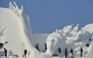 """Workers carve the main sculpture """"Snow song Winter Olympics"""" for the 30th Harbin Sun Island international Snow Sculpture Art Exposition on December 7, 2017 in Harbin, China. The 30th Harbin Sun Island International Snow Sculpture Art Exposition runs from 20 December 2017 to 28 February 2018."""