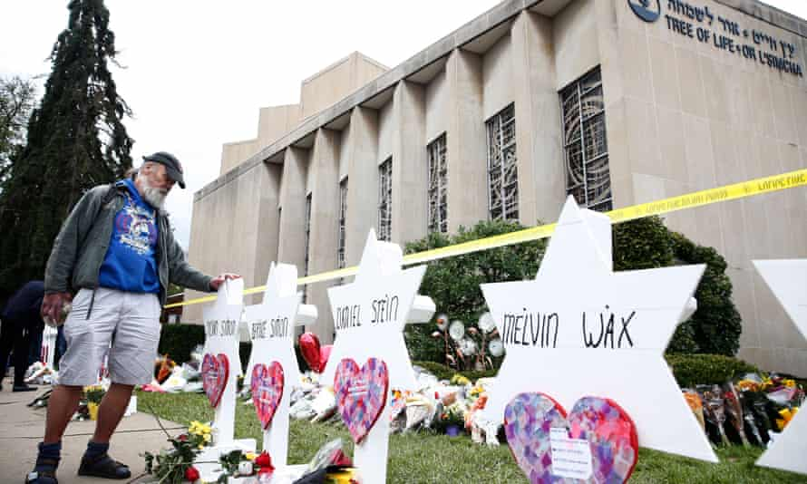 A man pauses at the memorials set up for each of the 11 people killed at the mass shooting at the Tree of Life synagogue in Pittsburgh, Pennsylvania.
