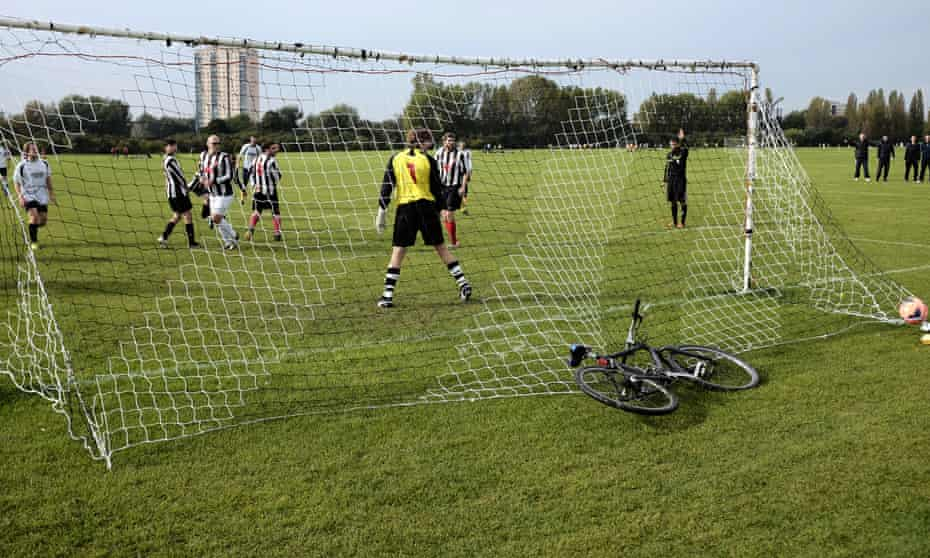 An amateur match on Hackney Marshes, but there are fewer people playing sport now than before 2012.