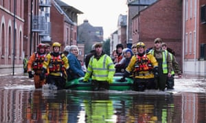 Members of Cleveland mountain rescue and soldiers evacuate guests from a flooded hotel in York city centre in December 2015.