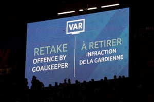 A big TV screen showing the ruling made following a VAR review during a group A match between Nigeria and France at Roazhon Park.