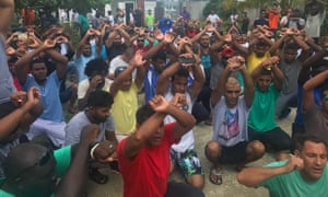 This handout picture taken on 31 October 2017 by Nick McKim, Australian Greens senator for Tasmania, shows refugees gesturing inside Manus detention camp in Papua New Guinea.