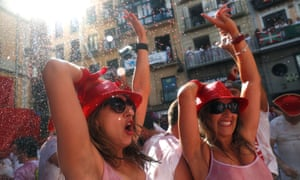 Women celebrate the firing of chupinazo, which opens the San Fermín festival in Pamplona