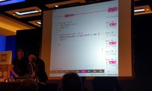 Code Mesh 2016 keynote 'Distributed Jamming with Sonic Pi and Erlang'. Joe Armstrong adjusts a synth under instruction from Sam Aaron. The screen behind them shows Sonic Pi running.