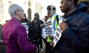 Justin Welby meets gay rights campaigners protesting outside Canterbury Cathedral following the conclusion of the primates' gathering.