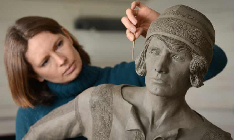 Sculptor Hannah Stewart works on the Lily Parr statue
