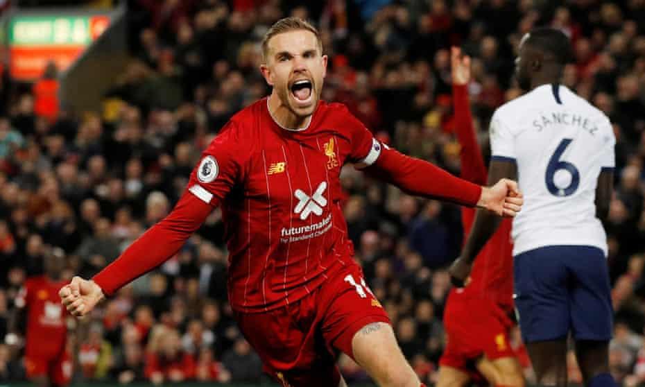 Jordan Henderson celebrates scoring for Liverpool against Tottenham at Anfield this season.