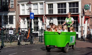 Children on an electric cargo bike in Amsterdam, Netherlands.