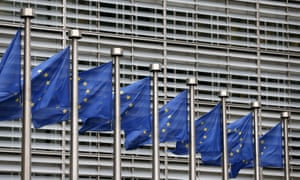 European Union flags flutter outside the EU Commission headquarters in Brussels.