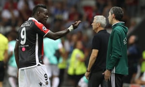 Mario Balotelli complains to fourth official Tomaz Klancnik, apparently over a bracelet that had to be covered with a bandage.