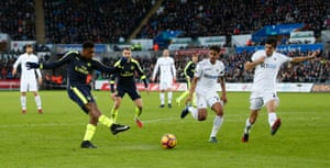 Arsenal's Alex Iwobi shoots at goal leading to Swansea City's Jack Cork deflecting to score an own goal and the second for Arsenal.