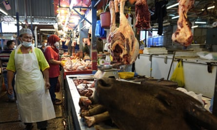 A poultry butcher at a wet market in Kuala Lumpur.
