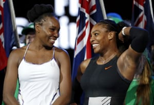 Serena Williams, right, and her sister Venus smile together after Serena won their women's singles final.