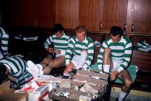 Jimmy Johnstone, centre, puts on his football boots in the Celtic dressing room at Hampden Park