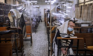 Ultra-Orthodox Jews wear face masks during morning prayer in a synagogue in Bnei Brak, Israel
