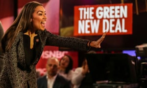Alexandria Ocasio-Cortez greets audiences following a televised town hall event on the Green New Deal in New York City on 29 March 2019.