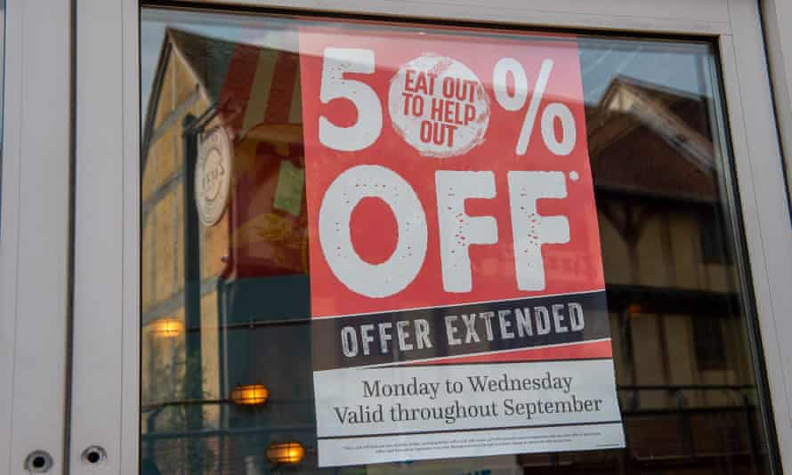 An EAt Out to Help Out offer extended sign in a restaurant window