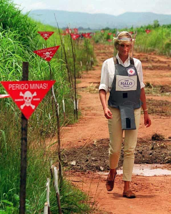 Princess Diana walking through a minefield in Angola in 1997