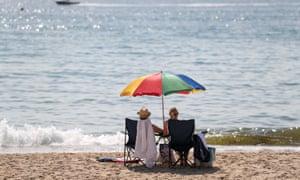 People sunbathe on Boscombe beach in Dorset.