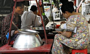 People eating mohinga in downtown Yangon.