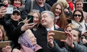 Petro Poroshenko poses for selfies with Ukrainians after a mass prayer for fair elections in Kiev.