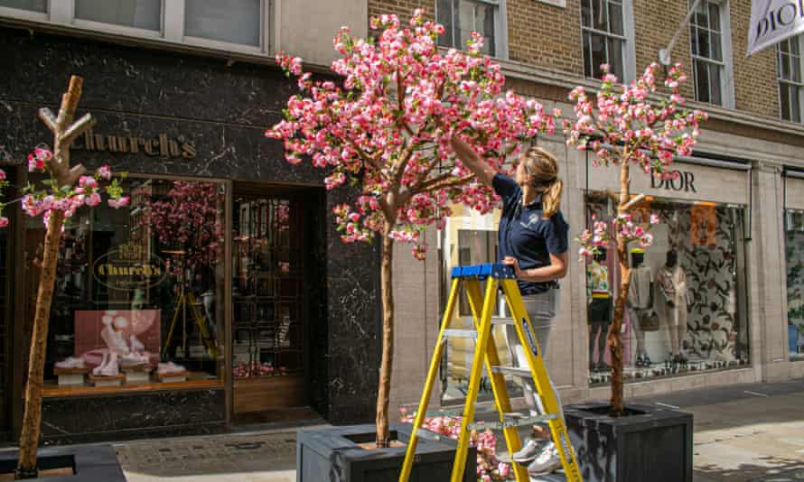 New cherry blossom trees in New Bond Street, London, as shops prepare to reopen.
