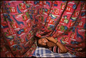 Kamla behind curtains with a customer, Falkland Road, Bombay, India, 1978