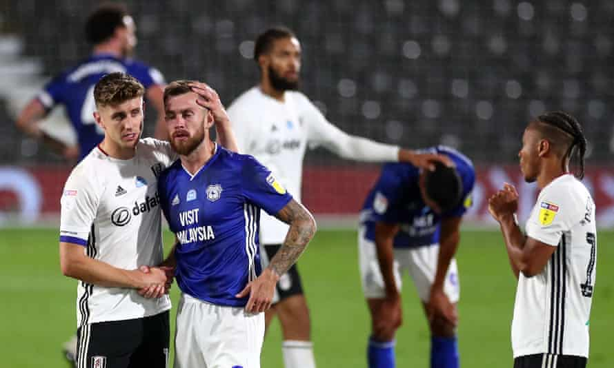 Tom Cairney (left) consoles Joe Ralls of Cardiff City after the final whistle.