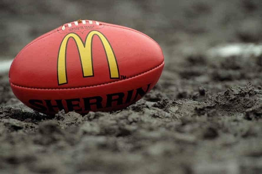 A football sitting in mud