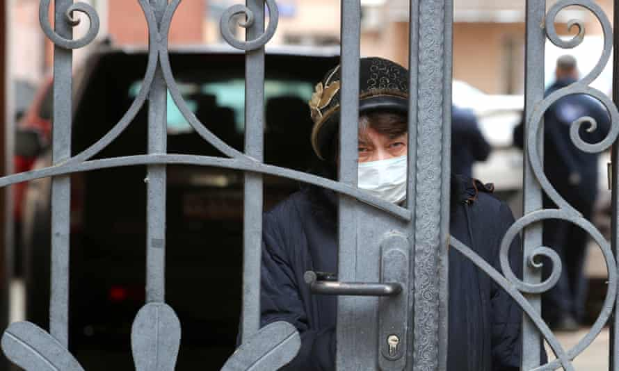 A woman in a face mask in Moscow, where officials have imposed strict isolation measures.