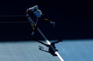 Novak Djokovic serves during his win over Denis Shapovalov.