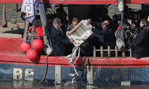 Nigel Farage throws fish into the Thames to protest against common fisheries policy.