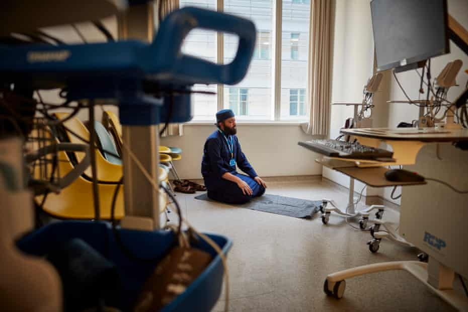20 May: Imam Faruq Siddiqi, the Muslim chaplain for the Royal London hospital in east London, prays in an empty consulting room during Ramadan.