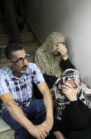 Relatives mourn outside a hospital's morgue in the West Bank city of Bethlehem after Mutaz Ibrahim Zawahreh was killed in clashes with Israeli security forces.