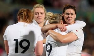 England's players console each other following their loss to New Zealand on Saturday.
