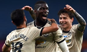 Paul Pogba celebrates scoring Manchester United's third goal,
