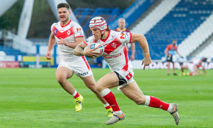 Theo Fages breaks clear for St Helens to open the scoring early on against Huddersfield