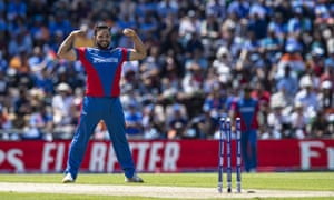 Gulbadin Naib of Afghanistan celebrates after taking the wicket of Mohammed Shami.