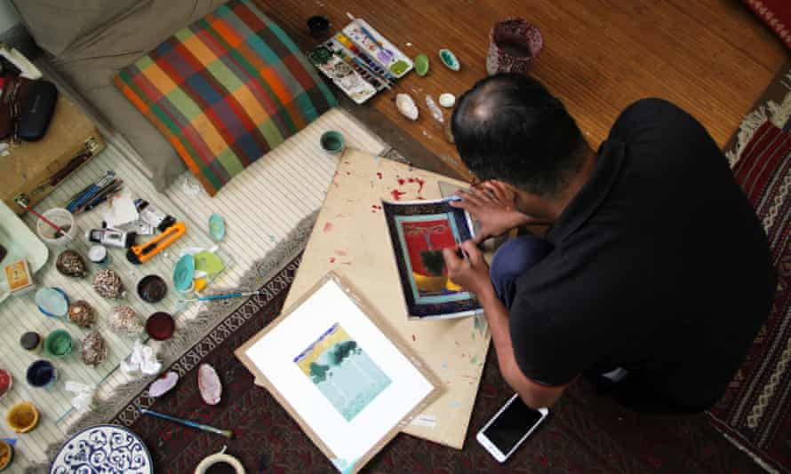 Qureshi at work on paintings for his exhibition Where the Shadows Are So Deep.