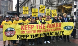 RMT general secretary Mick Cash joins a picket line outside Waterloo station in London as strike action over cuts to guards on trains begins.