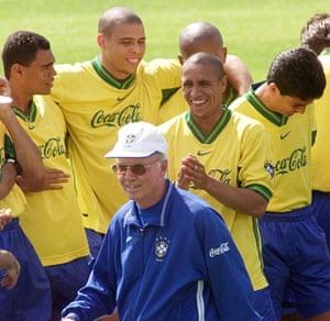 Denílson, Ronaldo, Roberto Carlos and Bebeto amuse themselves after a chat with Brazil coach Mario Zagallo.