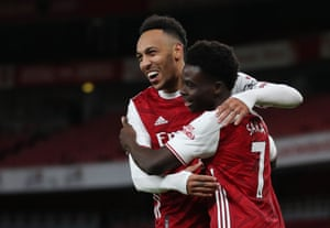The two Arsenal goal scorers celebrate Saka's goal.