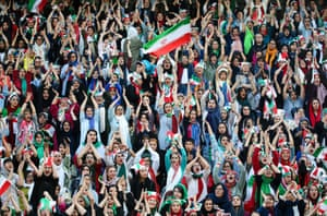 Iranian women, barred for 40 years from attending football matches, watch the World Cup qualifier between Iran and Cambodia in Tehran. The Islamic republic relaxed its stance after Fifa threatened to suspend the country over its policy.
