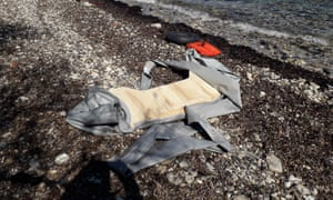The remains of a newly landed inflatable dinghy on a beach on Lesbos