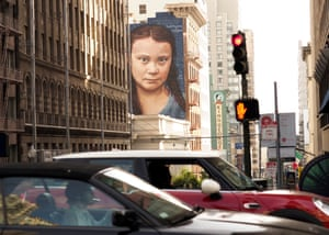 A mural on a side of a San Francisco building depicts Swedish teenage climate activist Greta Thunberg.