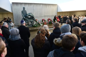 People attend a wreath-laying ceremony at the Sachsenhausen camp memorial